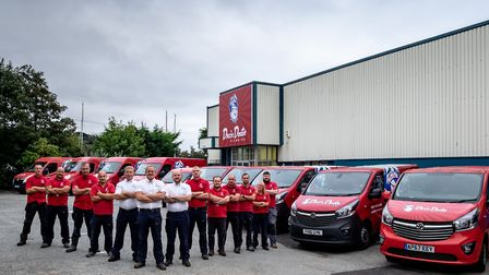 The Drain Doctor Anglia team oudtside their new premises in Woodbridge. Picture: DRAIN DOCTOR