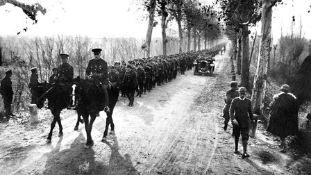 The Gloucestershire Regiment marches through Piave on the way to the front at Asiago, Italy, during