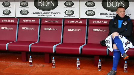 Everton's Wayne Rooney sits on the bench during the Premier League match at Turf Moor, Burnley. Phot