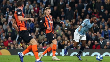 Manchester City's Raheem Sterling (right) goes down inside the box, resulting in a penalty during th
