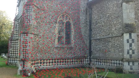 More than 6,000 poppies have been hung from the tower of St Mary's Church in Walsham Picture: JANE B