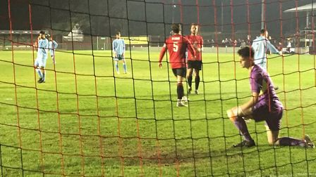 Woodbridge keeper, Alfie Stronge, is beaten by Max York's first-half penalty at Histon. Picture: CAR