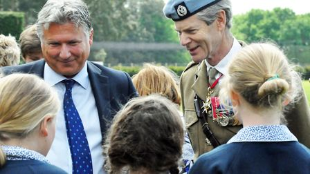 Headmaster Adrian Brown and General Sir Adrian Bradshaw talk with pupils after a recent Desert Rats