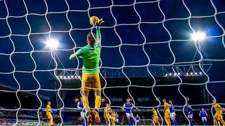 Stand-in keeper Paul Gallagher gets a palm to the ball, to deny Danny Rowe, late in the Ipswich Town