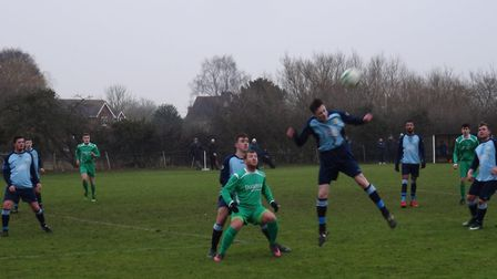 James Heathcote, in green, was on target for East Bergholt as they beat SIL Senior leaders Capel Pol