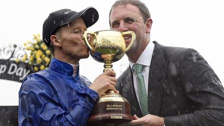 Jockey Kerrin McEvoy, left and English trainer, Charlie Appleby, right celebrate after winning the M