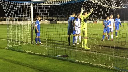 Goalmouth action as Leiston prepare to defend a corner during the Suffolk derby against Lowestoft in