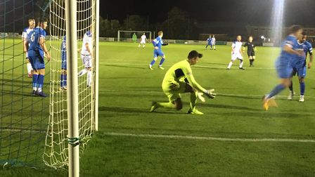 Leiston keeper Charlie Beckwith prepares to deal with a shot during the first half against Lowestoft