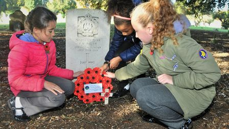 Children leaving a wreath at Ipswich Cemetery. Picture: JADE GIDDENS/Ipswich Council