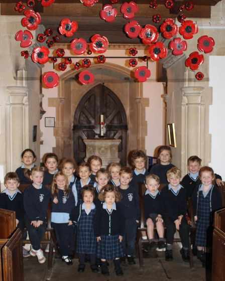 Culford pupils with the poppy display in St Mary's Church Picture: CULFORD SCHOOL