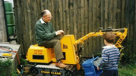 Ever game. John at the controls of a digger in 2002 while great-nephew Alex looks on. Picture: POTTE