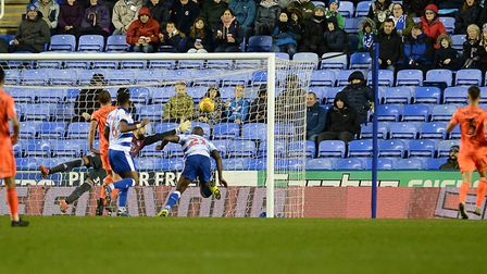 Yakou Meite scores Reading's equaliser with a free header with his marker Jonas Knudsen off to the r