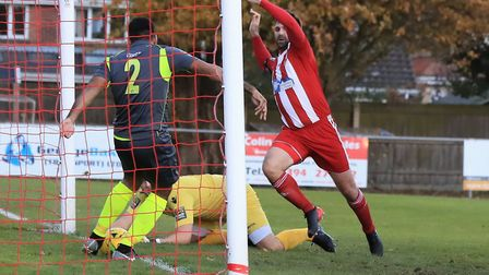 Was it over the line? Grays' Ryan Mahal clears the ball away from the advancing Rhys Barber Photo: S