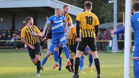 Goalmouth action at Greens Meadow on Saturday Photo: DAWN MATTHEWS