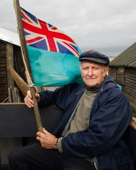 Tony on deck with an old flag Picture: SARAH LUCY BROWN