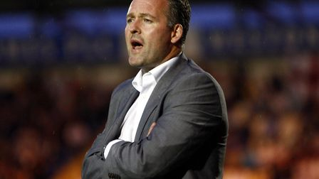 A rare occasion when then-U's boss Paul Lambert opted for a suit rather than a track-suit. Picture: