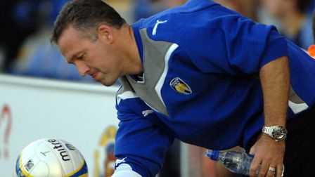 Paul Lambert collects the ball on the sidelines, during his days as Colchester manager