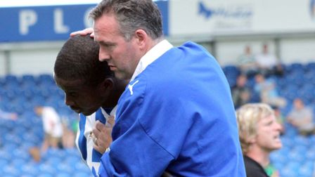 Paul Lambert comforts Kevin Lisbie when the striker is substituted, during the 2-1 win over Yeovil.
