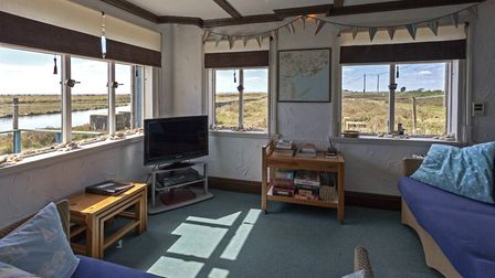 The cosy living room in the Beach House Picture: AIRBNB
