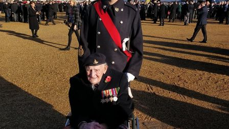 Eric Cook and grandson Julian in London on Remembrance Sunday Picture: RUSSELL COOK