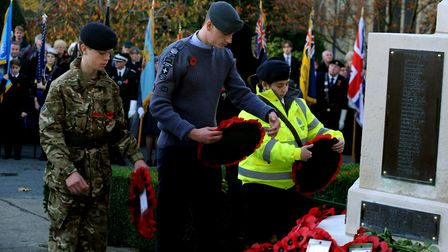 Gathering at the War Memorial by St Gregory's Parish Church in Sudbury for the Remembrance Day wreat