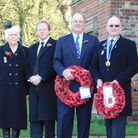 Taking the salute at Melford Hall gates, left to right: Audrey Wreford, chairman of Long Melford RBL