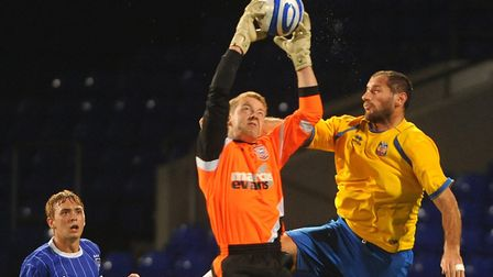 Supple challenges with former Ipswich striker Shefki Kuqi in a reserve game. Picture by Alex Fairful