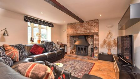 Fornham Road Farm living room with open fire Picture: BEDFORDS