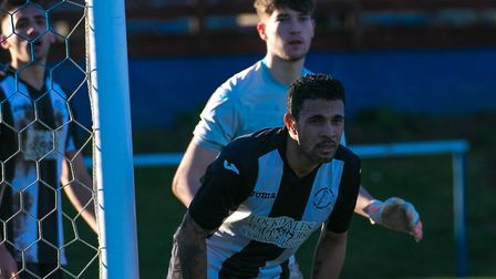 Woodbridge Town's Carlos Edwards and keeper Alfie Stronge. Picture: PAUL LEECH