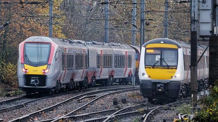The new Greater Anglia Stadler train passes a Turbostar diesel unit - one of the units it will repla