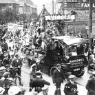 A parade passing from Norwich Road into St Matthews Street, at Barrack Corner, Ipswich, to mark vict
