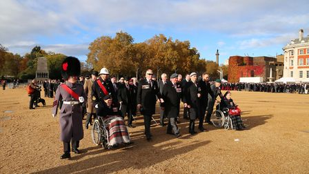 Eric Cook and WO Second Class Julian Cook line up with the rest of the members of Blind Veterans UK