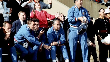 England team manager Alf Ramsey (sitting right) and trainer Harold Sheperdson (standing) watch Engla