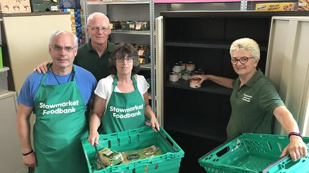 Shelves were bare at the Stowmarket and area foodbank this summer. Pictured are Andrew McFarlane, Mi