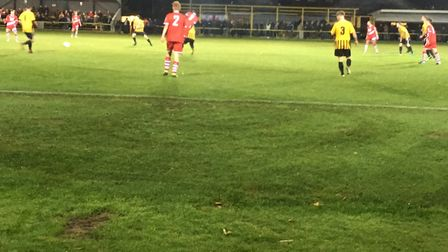 The scene of the Suffolk Premier Cup clash between hosts Stowmarket Town (gold shirts) and AFC Sudbu