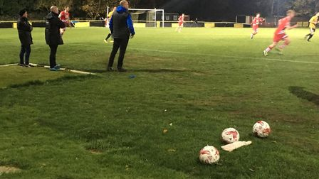 The AFC Sudbury coaching staff, including manager Mark Morsley, look on as the visitors concede thre