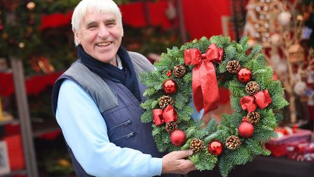 The Bury St Edmunds Christmas Fayre features stalls selling Christmas decorations, food and drink, g
