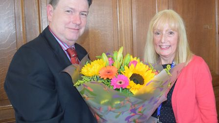 Mary Foster receiving flowers from Tendring District Council chief executive Ian Davidson Picture: W