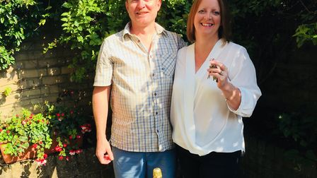 Julie and Steve Penney with the keys to their new pub, The Swan in Monks Eleigh Picture: Julie Penn