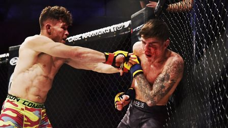Steve Aimable unloads some heavy shots on his way to beating Josh Abrham at Cage Warriors 99. Pictur