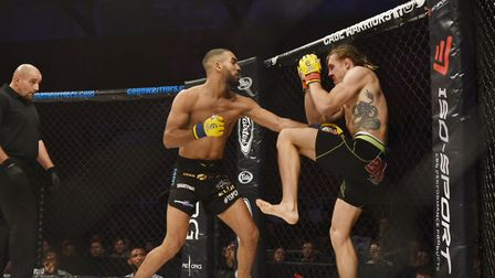 Mehdi Ben Lakhdar, left, on his way to a win over hometown favourite Craig Edwards at Cage Warriors
