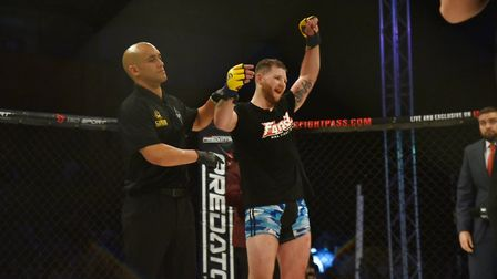 Jamie Richardson has his hand raised at Cage Warriors 99 in Colchester. Picture: BRETT KING