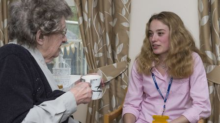 Anna Morley with one of the residents at the Hillside Care Home in Great Cornard. Picture: PAUL SANW
