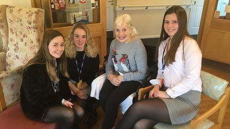 Chloe Jackson, Anna Morley and Kyra Jackson with Hillside Care Home resident Yvonne Glen. Picture: R
