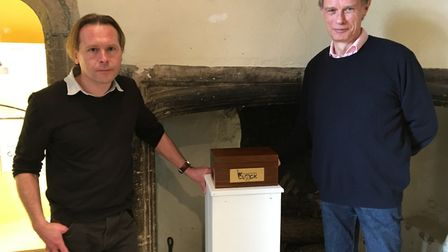 Heritage officer Alex MxWhirter and physicist Antony Hurdern with Schrodinger's Clock at Moyse's Hal