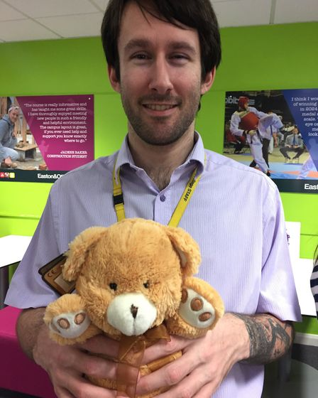 Ryan Crisp and his teddy Ed who he has brought to work for Children in Need Picture: JOHN NICE
