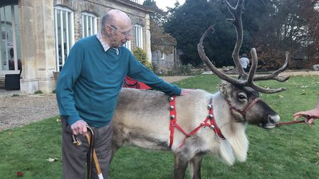 Resident Quinton Clayton with Blitzen the reindeer Picture: ALEX BALL