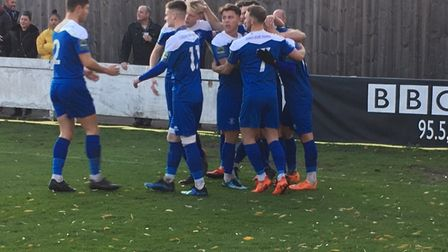 Bury Town players celebrate Cemal Ramadan's sucessful third minute penalty, against Coggeshall .