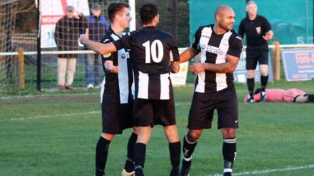 Hat trick hero Kelsey Trotter congratulated by Carlos Edwards and Alex Greggor after putting Woodbri