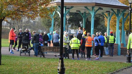 Runners, joggers and walkers assemble before the start of the Harwich parkrun, next to the bandstand